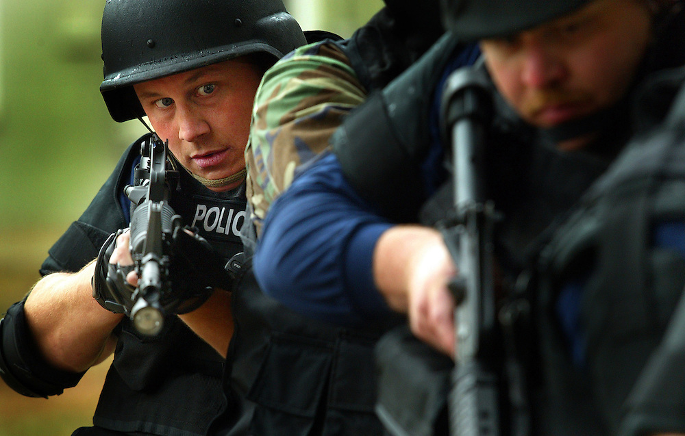 SWAT officer Ryan Williams works in close formation while practicing maneuvers during SWAT School in Muncie Ind. Officers from all over Indiana come to Muncie to participate in a SWAT school once a year. The school is designed for officers new to SWAT or teams just starting up.