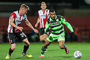 Forest Green Rovers Dan Wishart(17) takes on Cheltenham Town's Taylor Moore(28) during the EFL Trophy match between Cheltenham Town and Forest Green Rovers at Whaddon Road, Cheltenham, England on 3 October 2017. Photo by Shane Healey.