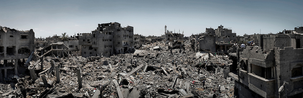 Gaza Strip, Gaza City: Overview of Shujaya district taken from the damaged El Murabetin mosque during the ceasefire on July 26, 2014. Photo merge of 8 frame in sequence. ALESSIO ROMENZI