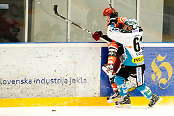 Hafner Tomi of HK Jesenice and Spannring Patrick of EHC Linz during ice-hockey match between HK Acroni Jesenice and EHC Liwest Black Wings Linz in 43rd Round of EBEL league, on Januar 17, 2012 at Dvorana Podmezaklja, Jesenice, Slovenia. (Photo By Urban Urbanc / Sportida)