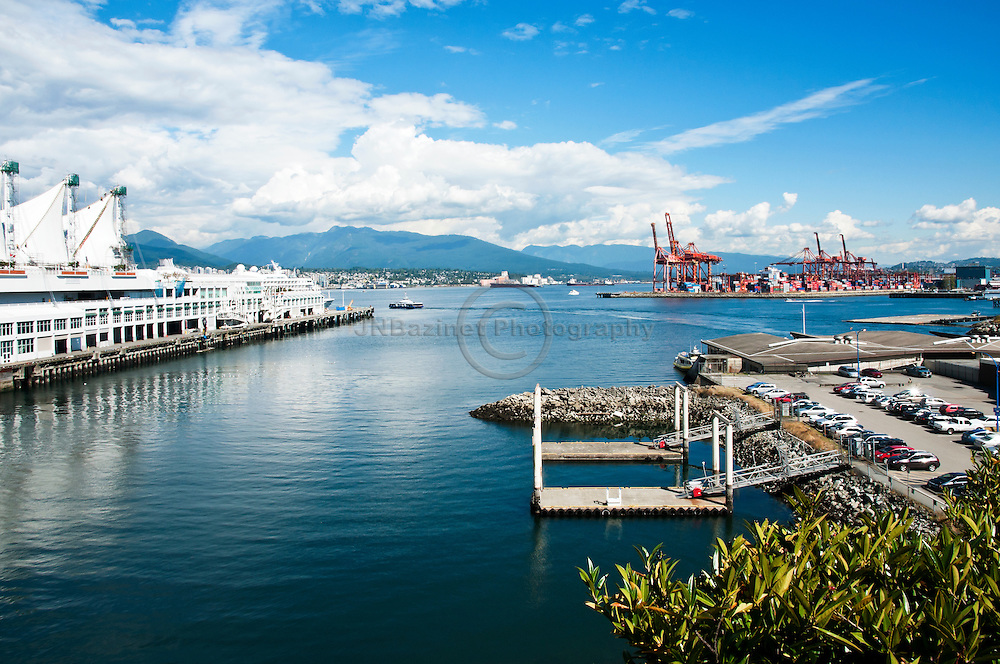 Vancouver Harbour from the south shore of the city; highlighting Canada Place and cargo shipping dock.