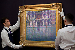 © Licensed to London News Pictures. 14/06/2013. London, UK. Two Sotheby's employees adjust 'Le Palais Contarini' (1908, est. GB£15,000,000-20,000,000) by French impressionist Claude Monet at the press view for a Sotheby's auction in London today (14/06/2013). The Impressionist and Modern Art Evening Sale takes place on the 19th of June 2013 at Sotheby's New Bond Street premises.  Photo credit: Matt Cetti-Roberts/LNP