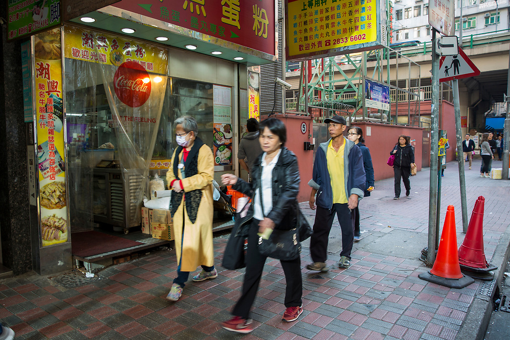 Pedestrians commuting and shopping on the streets of Hong Kong. (photo by Andrew Aitchison / In pictures via Getty Images)