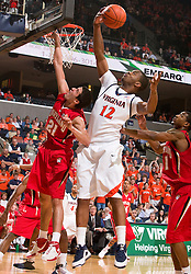 Virginia forward Jamil Tucker (12) grabs a rebound over Maryland guard Greivis Vasquez (21).  The Virginia Cavaliers defeated the Maryland Terrapins 68-63 at the John Paul Jones Arena on the Grounds of the University of Virginia in Charlottesville, VA on March 7, 2009.