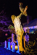"A scarecrow and owl loom over Chris Baker's haunted yard in South Yarmouth, MA. Every year Baker sets up an elaborate Halloween display in his yard and on Halloween, neighborohood residents walk through his frightening ""vortex"" of horror while trick or treating."