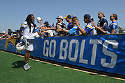Jul 29, 2018; Costa Mesa, CA, USA; Los Angeles Chargers receiver Travis Benjamin (12) is greeted by fans during training camp at Jack R. Hammett Sports Complex.