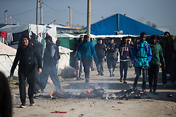 "© Licensed to London News Pictures . 23/10/2016 . Calais , France . The Calais migrant camp known as "" The Jungle "" , in Northern France , on the final day before the eviction and destruction of the camp . Photo credit: Joel Goodman/LNP"