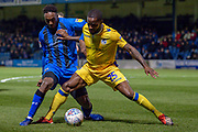 Gillingham FC forward Brandon Hanlan (7) and Bristol Rovers midfielder Abu Ogogo (25)  during the EFL Sky Bet League 1 match between Gillingham and Bristol Rovers at the MEMS Priestfield Stadium, Gillingham, England on 12 March 2019.