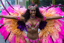 London, August 29th 2016. Colourful, complicated costumes give a festive look to the parade during day two of Europe's biggest street party, the Notting Hill Carnival.