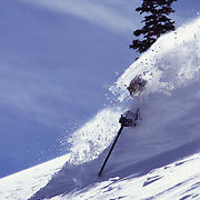A man telemark skiing in the Utah back country.