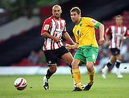 London - Tuesday, August 18th, 2009: David Hunt of Brentford and Grant Holt of Norwich City during the Coca Cola League One match at Griffin Park, London. (Pic by Chris Ratcliffe/Focus Images)