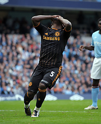 Michael Essien reacts after missing a chance during the Barclays Premier League match between Manchester City and Chelsea at the City of Manchester Stadium on September 25, 2010 in Manchester, England.