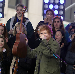 March 8, 2017 - New York, New York, U.S. - Singer ED SHEERAN holds up a guitar on the 'Today' show held at Rockefeller Plaza. (Credit Image: © Nancy Kaszerman via ZUMA Wire)