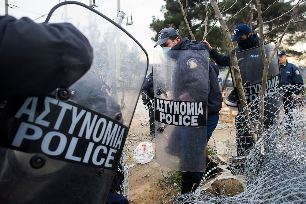 Greek police arrive at a gate in the fence to respond to rising tensions as several refugees were let through the Macedonian (FYROM) border on March 6, 2016 in Idomeni, Greece. Approximately 50 refugees were let through on the 6th, or less than 1% of the estimated 13,000 people housed in the camp.