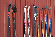 Ski rest in row against side of building at the international science village of Ny-Alesund on Spitsbergen island in Kongsfjorden; Svalbard, Norway.