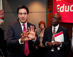 © Licensed to London News Pictures. 23/3/2013. Birmingham, UK. Labour Policy Forum at the ICC. Pictured, Labour Leader Ed Miliband  watched by Everton Burke, Governor of Burton and South Staffs College.Photo credit : Dave Warren/LNP