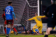 AFC Wimbledon midfielder Dean Parrett (18) scores a goal and celebrates to make the score 0-1 during the EFL Sky Bet League 1 match between Scunthorpe United and AFC Wimbledon at Glanford Park, Scunthorpe, England on 28 February 2017. Photo by Simon Davies.