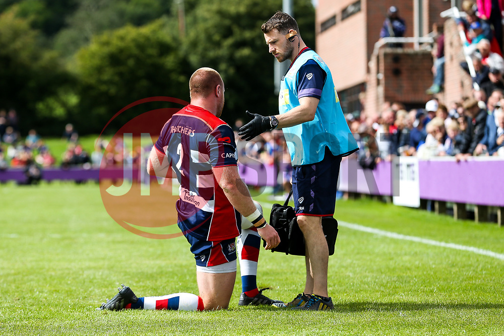 Ross McMillan of Bristol Rugby receives treatment from Rory Murray - Rogan/JMP - 19/08/2017 - RUGBY UNION - Clifton Rugby Club - Bristol, England - Bristol Rugby v Scarlets - Pre-Season Friendly.