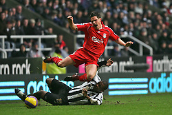 Newcastle, England - Saturday, February 10, 2007: Liverpool's Steve Finnan is brought down  by Newcastle United's Titus Bramble during the Premiership match at St James' Park. (Pic by Dave Kendall/Propaganda)