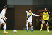Nathan Holland of Oxford United (27) and John Brayford of Burton Albion (2) battle for the ball during the EFL Sky Bet League 1 match between Burton Albion and Oxford United at the Pirelli Stadium, Burton upon Trent, England on 11 February 2020.