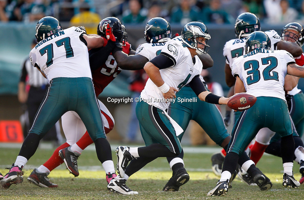 Philadelphia Eagles quarterback Kevin Kolb (4) hands off the ball on a running play during the NFL week 6 football game against the Atlanta Falcons on Sunday, October 17, 2010 in Philadelphia, Pennsylvania. The Eagles won the game 31-17. (©Paul Anthony Spinelli)