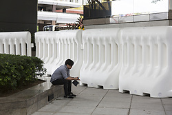 June 27, 2017 - Hong Kong, Hong Kong - Police officers set Water-Safety Barriers on the road in Wan Chai, Hong Kong. Police forces was preparing the security for China's President Xi Jinping attending the celebration of the 20th Anniversary of Hong Kong's Reunification. (Credit Image: © Chan Long Hei/Pacific Press via ZUMA Wire)