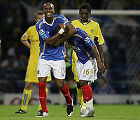Photo: Lee Earle.<br /> Portsmouth v Leeds United. Carling Cup. 28/08/2007.Portsmouth's Sylvain Distin (L) congratulates Noe Pamarot after he scored their second.