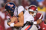 FAYETTEVILLE, AR - NOVEMBER 22:  Markell Pack #11 of the Ole Miss Rebels is tackled by Tevin Mitchel of the Arkansas Razorbacks at Razorback Stadium on November 22, 2014 in Fayetteville, Arkansas.  The Razorbacks defeated the Rebels 30-0.  (Photo by Wesley Hitt/Getty Images) *** Local Caption *** Markell Pack; Tevin Mitchel
