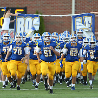 Booneville players take the field before the start of Friday night's Skunk Bowl game against Baldwyn.