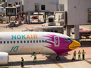 02 APRIL 2015 - BANGKOK, THAILAND:  A NOK Airlines Boeing 737 at its gate at Don Mueang Airport in Bangkok. The International Civil Aviation Organization (ICAO), a United Nations agency, issued a report critical of record keeping and maintenance reports for Thailand's civil aviation industry, including most Thai air carriers. The ICAO report allegedly showed that the Thai Department of Civial Aviation (DCA) was able to meet only 21 out of 100 ICAO requisites. Several Asian countries, including South Korea, Japan and China have imposed limits of Thai registered aircraft since the release of the ICAO report and the European Union has begun to review the safety records of Thai Airways International (THAI) aircraft that fly to Europe.    PHOTO BY JACK KURTZ
