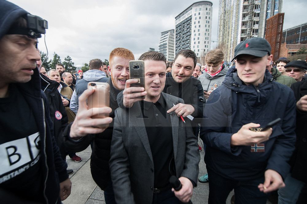 © Licensed to London News Pictures . 24/03/2018. Birmingham, UK. Former EDL leader TOMMY ROBINSON is seen acting as a journalist for Rebel Media at a Football Lads Alliance demonstration against Islam and extremism in Birmingham City Centre . Offshoot group, The True Democratic Football Lads Alliance, also hold a separate demonstration . Photo credit: Joel Goodman/LNP