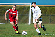Essex's Noah Ferris (21) runs past CVU's Todd Boisjoli (5) with the ball during the boys soccer game between the Champlain Valley Union Redhawks and the Essex Hornets at Essex High School on Saturday mooring October 10, 2015 in Essex. (BRIAN JENKINS/For the FREE PRESS)