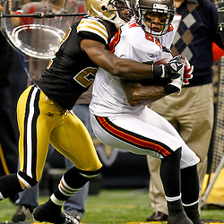November 6, 2011; New Orleans, LA, USA; New Orleans Saints safety Malcolm Jenkins (27) tackles Tampa Bay Buccaneers tight end Kellen Winslow (82) during the second quarter of a game at the Mercedes-Benz Superdome. Mandatory Credit: Derick E. Hingle-US PRESSWIRE