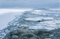 Antarctica Weddell Sea Ice floe clouds reflecting in water