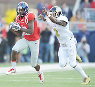 Ole Miss Rebels wide receiver Vince Sanders (10) makes a catch against Mississippi State Bulldogs defensive back Will Redmond (2) at Vaught-Hemingway Stadium in Oxford, Miss. on Saturday, November 29, 2014.