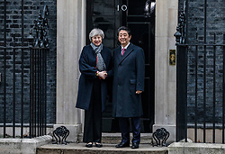 © Licensed to London News Pictures. 10/01/2019. London, UK. Prime Minister Theresa May (L) and Prime Minister of Japan Shinzo Abe (R) outside 10 Downing Street ahead of a bilateral meeting between the two leaders. Photo credit: Rob Pinney/LNP