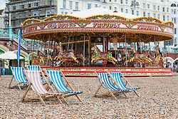© Licensed to London News Pictures. 11/06/2017. Brighton, UK. Deck chairs stand unused on the beach in Brighton and Hove as strong winds and powerful waves are hitting the seaside resort. Photo credit: Hugo Michiels/LNP