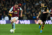 Aston Villa midfielder John McGinn (7) sprints forward with the ball  chased by Wolverhampton Wanderers defender Ruben Vinagre (29) during the EFL Cup match between Aston Villa and Wolverhampton Wanderers at Villa Park, Birmingham, England on 30 October 2019.