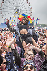 © Licensed to London News Pictures . 07/06/2014 . Heaton Park , Manchester , UK . The audience in front of the main stage . The Parklife music festival in Heaton Park Manchester following heavy overnight rain . Photo credit : Joel Goodman/LNP