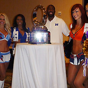 The sparkling NFL Pro Bowl Trophy is decorated with lovely NFL Cheerleaders and Green Bay Packer's receiver, Greg Jennings.  Photo by Barry Markowitz, 1/24/12, 12:25pm