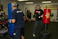 "James St Pierre, Mike O'Neill and Mike Rollins take a round on the punching bags during ""Rock Steady Boxing"" at the Downtown Gym Thursday evening.  (Karen Bobotas/for the Laconia Daily Sun)"