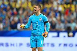 England goalkeeper Tom Heaton celebrates his sides first goal of the match