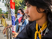 30 NOVEMBER 2013 - BANGKOK, THAILAND: Anti-government students from Ramkhamhaeng University in Bangkok at a road block to stop pro-government Red Shirts from entering their campus Satuday. Political faultlines in Bangkok, the Thai capital, hardened Saturday. Antigovernment factions repeated promises to strike at the heart of Bangkok Sunday and bring down the government while thousands of Red Shirts, who support the government, have come to Bangkok from their base in rural Thailand to defend the government. Prime Minister Yingluck Shinawatra has appealed for calm, but her opponents have rejected all requests for negotiations saying the only acceptable outcome is the eradication of the government.        PHOTO BY JACK KURTZ