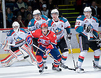 KELOWNA, CANADA, JANUARY 4: Adam Brown #1, Colton Heffley #25, Mitchell Chapman #5 and Mackenzie Johnston #22 of the Kelowna Rockets and Michael Aviani #16 of the Spokane Chiefs skate up ice as the Spokane Chiefs visit the Kelowna Rockets on January 4, 2012 at Prospera Place in Kelowna, British Columbia, Canada (Photo by Marissa Baecker/Getty Images) *** Local Caption ***