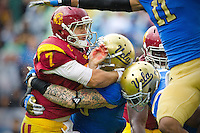 17 October 2012: Quarterback (7) Matt Barkley of the USC Trojans is hit by (99) Cassius Marsh of the UCLA Bruins after throwing the ball during the second half of UCLA's 38-28 victory over USC at the Rose Bowl in Pasadena, CA.