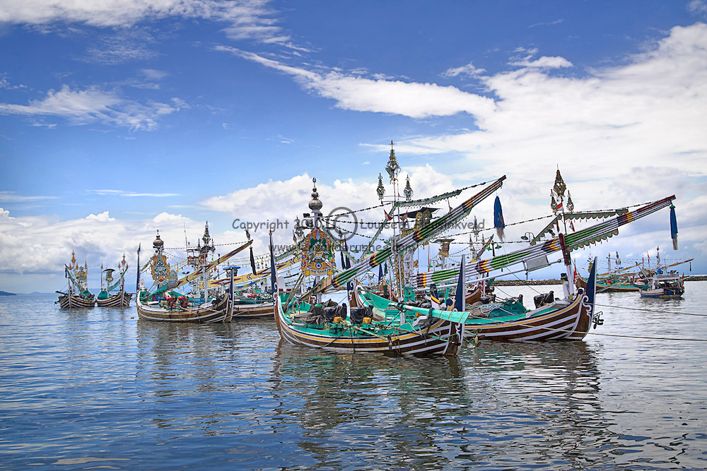Paired buggies, historic fishing boats in the harbour at Pangambengan, Bali, Indonesia