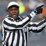 An umpire in action during the Yale V Brown, Ivy League Football match at Yale Bowl. Yale won the match 24-17. New Haven, Connecticut, USA. 9th November 2013. Photo Tim Clayton