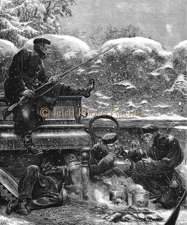 Franco-Prussian War 1870-1871: Prussian troops before Paris waiting for the sortie. One rifleman, bayonet fixed, sits on an upright piano keeping watch while his companions enjoy a meal and a smoke. Wood engraving, 17 December 1870.