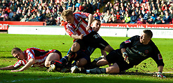 SHEFFIELD, ENGLAND - Saturday, March 1, 2008: Charlton Athletic's Darren Ambrose is tackled by two Sheffield United players and goalkeeper Paddy Kenny during the League Championship match at Bramall Lane. (Photo by David Rawcliffe/Propaganda)