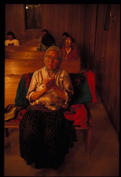 A believer listens to repentant sinners at Eugene Chee Sr., Methodist revival.  Oljeto, Utah  1993